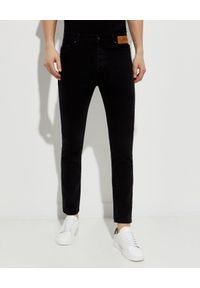 PALM ANGELS - Czarne jeansy z logo. Kolor: czarny. Długość: długie. Wzór: nadruk, aplikacja. Styl: klasyczny