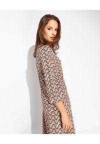 MALIPARMI - Brązowa wzorzysta koszula. Okazja: do pracy, na spotkanie biznesowe. Kolor: brązowy. Materiał: elastan, tkanina, wiskoza, materiał. Styl: klasyczny, biznesowy