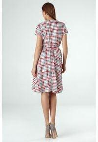 Colett - Elegancka rozkloszowana sukienka odcinana w pasie. Materiał: materiał. Długość rękawa: krótki rękaw. Typ sukienki: rozkloszowane. Styl: elegancki