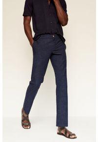 Mango Man - Spodnie ETNA. Kolor: niebieski. Materiał: materiał. Wzór: gładki