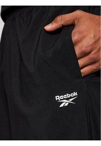 Reebok Classic - Reebok Spodnie dresowe Training Essentials Woven FP9170 Czarny Regular Fit. Kolor: czarny. Materiał: dresówka