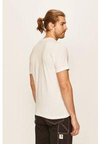 Biały t-shirt Puma casualowy, na co dzień