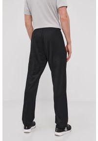 Reebok - Spodnie. Kolor: czarny. Materiał: materiał, tkanina, poliester. Wzór: gładki #4