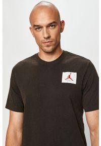Czarny t-shirt Jordan z aplikacjami, casualowy, na co dzień