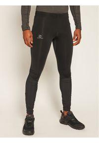 Czarne legginsy sportowe salomon