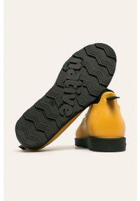 Żółte sneakersy Native z cholewką, na sznurówki
