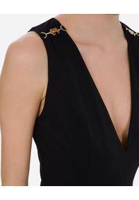 Elisabetta Franchi - ELISABETTA FRANCHI - Czarny kombinezon z pozłacanymi detalami. Kolor: czarny. Długość: długie. Styl: klasyczny