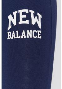 New Balance - Legginsy. Kolor: niebieski. Materiał: dzianina. Wzór: nadruk