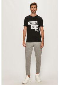 Szare spodnie dresowe Calvin Klein melanż