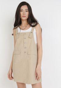 Born2be - Jasnobeżowa Sukienka Orethosa. Typ kołnierza: dekolt kwadratowy. Kolor: beżowy. Materiał: bawełna. Długość rękawa: na ramiączkach. Typ sukienki: koszulowe, trapezowe. Długość: mini