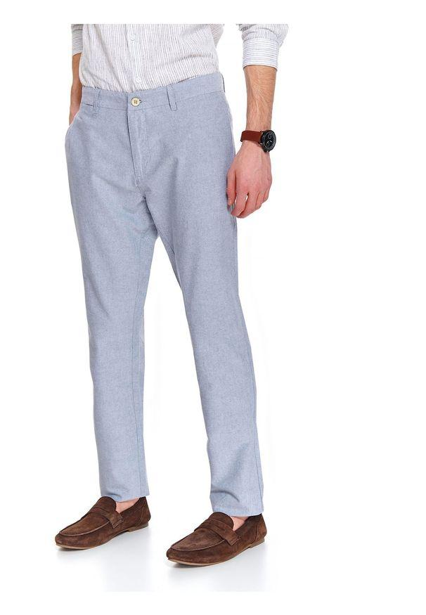 Niebieskie spodnie TOP SECRET długie, sportowe, w kolorowe wzory, na co dzień