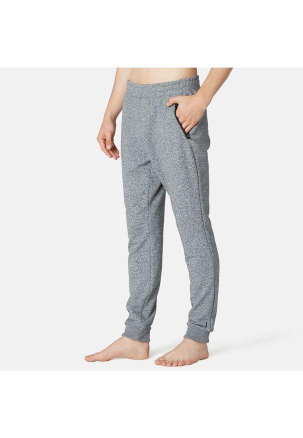 NYAMBA - Spodnie dresowe fitness slim. Kolor: szary. Materiał: dresówka. Sport: fitness