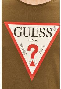 Oliwkowy t-shirt Guess Jeans z nadrukiem, z okrągłym kołnierzem