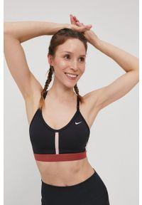 Nike - Biustonosz sportowy. Kolor: czarny. Materiał: włókno, skóra, tkanina. Rodzaj stanika: odpinane ramiączka, wyciągane miseczki. Technologia: Dri-Fit (Nike)