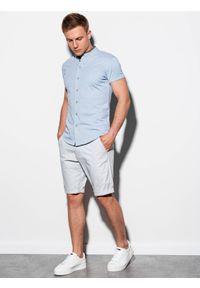 Ombre Clothing - Koszula męska z krótkim rękawem K543 - niebieska - XXL. Typ kołnierza: kołnierzyk stójkowy. Kolor: niebieski. Materiał: bawełna, tkanina, materiał. Długość rękawa: krótki rękaw. Długość: krótkie. Wzór: kolorowy. Sezon: lato