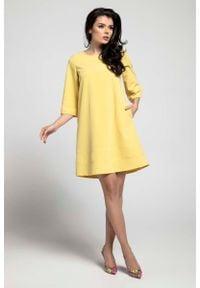 Nommo - Żółta Wizytowa Sukienka o Linii A z Przeszyciami. Kolor: żółty. Materiał: wiskoza, poliester. Styl: wizytowy