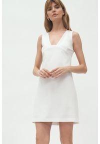Nife - Mini Sukienka bez Rękawów - Ecru. Materiał: poliester. Długość rękawa: bez rękawów. Długość: mini