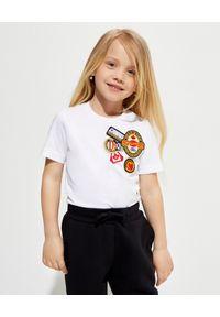 DSQUARED2 KIDS - Biała koszulka z naszywkami 4-16 lat. Kolor: biały. Materiał: bawełna. Wzór: aplikacja. Sezon: lato. Styl: klasyczny