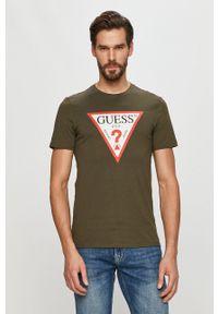 Guess - T-shirt. Okazja: na co dzień. Kolor: zielony. Materiał: dzianina. Wzór: nadruk. Styl: casual