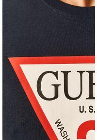 Niebieski t-shirt Guess Jeans z nadrukiem, casualowy, na co dzień
