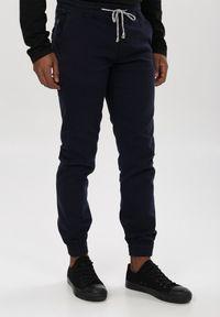 Born2be - Granatowe Spodnie Joggery Parsleybutton. Kolor: niebieski