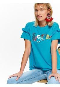 TOP SECRET - T-shirt damski z aplikacją. Typ kołnierza: kołnierz z falbankami. Kolor: niebieski. Materiał: tkanina, bawełna. Długość rękawa: krótki rękaw. Długość: krótkie. Wzór: aplikacja. Sezon: lato. Styl: wakacyjny