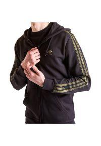 Adidas - ADIDAS CAMOUFLAGE HOODIE > FM3354. Typ kołnierza: kaptur. Materiał: bawełna