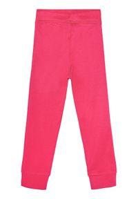 Różowe spodnie dresowe Reima