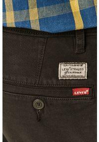 Czarne spodnie Levi's® w kolorowe wzory, na spotkanie biznesowe