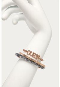 Złota bransoletka Guess ze stali, z kryształem, z aplikacjami