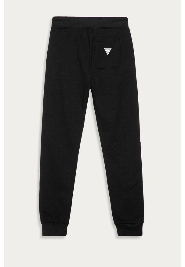 Czarne spodnie dresowe Guess Jeans z aplikacjami