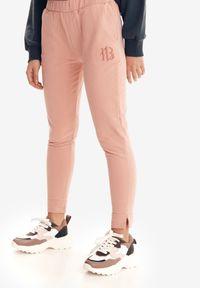Różowe spodnie z wysokim stanem Born2be