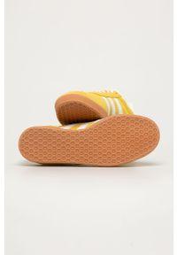 Żółte buty sportowe adidas Originals na sznurówki, z okrągłym noskiem, z cholewką