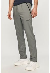 Nike - Spodnie. Okazja: na co dzień. Kolor: szary. Materiał: tkanina, skóra, włókno. Styl: casual