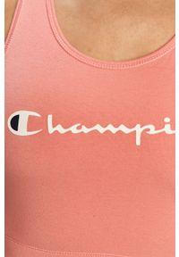 Champion - Biustonosz sportowy. Kolor: różowy. Wzór: nadruk