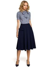 MOE - Elegancka rozkloszowana spódnica midi z kieszeniami. Materiał: elastan, materiał. Styl: elegancki