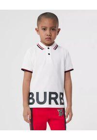 BURBERRY CHILDREN - Biała koszulka polo z nadrukiem 3-14 lat. Typ kołnierza: polo. Kolor: biały. Materiał: bawełna. Długość rękawa: krótki rękaw. Wzór: nadruk. Sezon: lato
