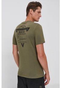 Guess - T-shirt bawełniany. Okazja: na co dzień. Kolor: zielony. Materiał: bawełna. Wzór: nadruk. Styl: casual