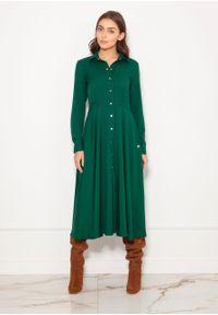 e-margeritka - Sukienka koszulowa długa elegancka zielona - 36. Okazja: do pracy. Kolor: zielony. Materiał: materiał, poliester. Długość rękawa: długi rękaw. Typ sukienki: koszulowe. Styl: elegancki. Długość: maxi