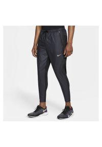 Spodnie biegowe męskie Nike Phenom Elite Shield Run CU7884. Materiał: dzianina, materiał, poliester. Technologia: Dri-Fit (Nike). Sport: bieganie