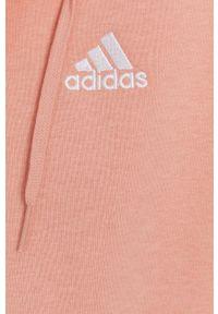 Adidas - adidas - Bluza. Okazja: na co dzień. Typ kołnierza: kaptur. Kolor: pomarańczowy. Materiał: bawełna, dzianina, poliester. Wzór: gładki. Styl: casual
