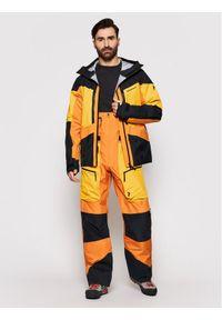 Pomarańczowe spodnie sportowe Peak Performance narciarskie