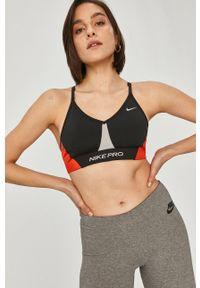 Nike - Biustonosz sportowy Indy. Kolor: czarny