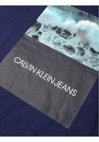 Niebieski t-shirt Calvin Klein Jeans z nadrukiem