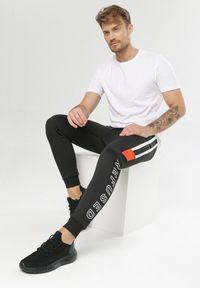Czarne spodnie dresowe Born2be #6