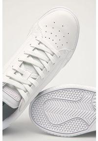 Białe sneakersy Lacoste na sznurówki, z cholewką, z okrągłym noskiem