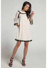 Beżowa sukienka Nommo trapezowa, wizytowa