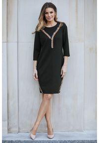 e-margeritka - Sukienka wizytowa czarna do kolan - 46. Okazja: do pracy. Kolor: czarny. Materiał: nylon, wiskoza, materiał, elastan. Wzór: aplikacja. Typ sukienki: proste, ołówkowe. Styl: wizytowy. Długość: midi
