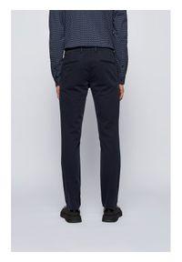 BOSS - Boss Chinosy Schino 50379152 Granatowy Slim Fit. Kolor: niebieski. Materiał: materiał