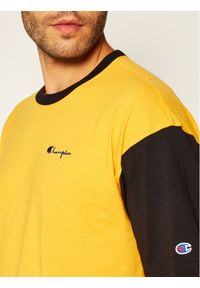 Champion T-Shirt Manica Logo 214285 Żółty Regular Fit. Kolor: żółty